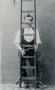 Houdini  handcuffed to a ladder